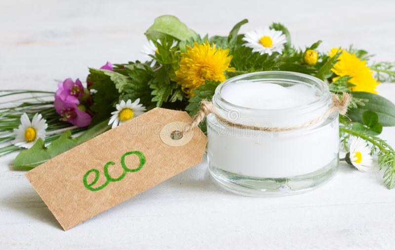 Natural cosmetics for skin care cream  eco label with herbs and flowers. On white stock images