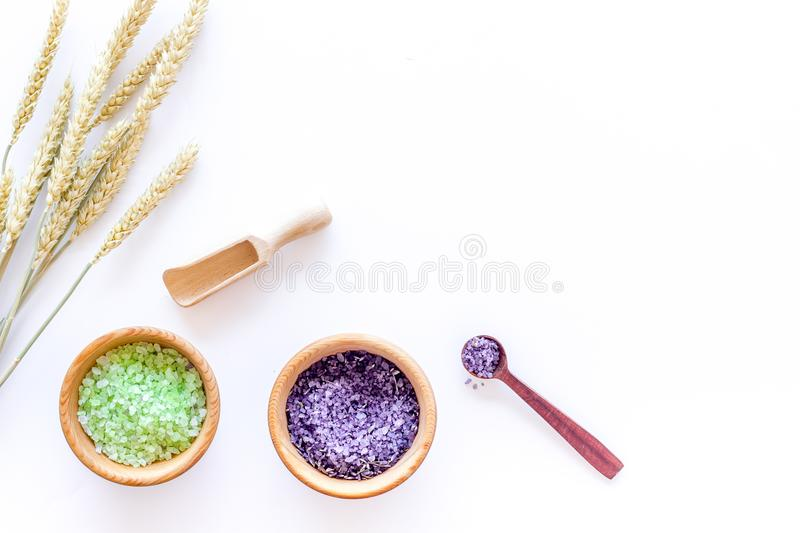 Natural cosmetics with wheat and herbs for homemade spa on stone background top view mock up stock photo