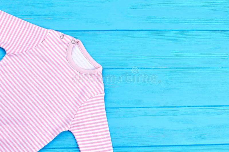 Natural cotton striped clothes for baby. Infant baby natural striped apparel and copy space. Infant kids brand clothes stock images