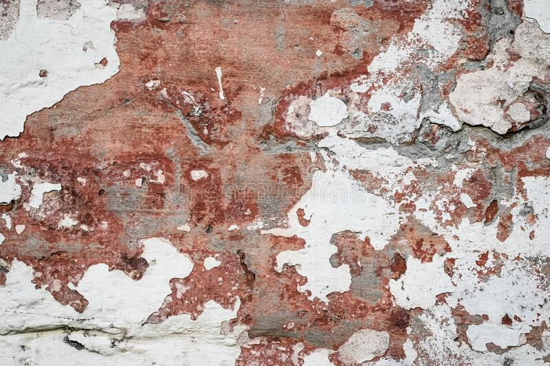 Natural destroyed stone surface. Vintage rustic pattern. Brown background. Old shabby cracked stucco. Dirty wall, grunge texture. Painted concrete, abstract royalty free stock images