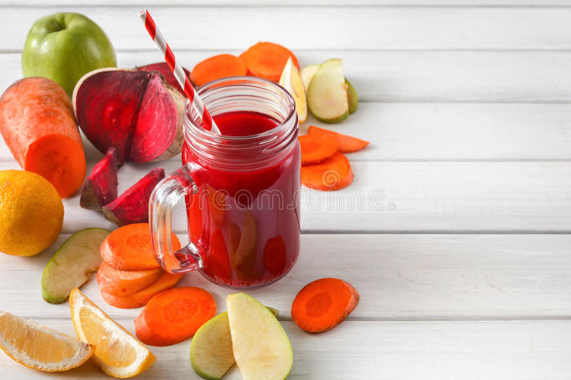 Natural detox beetroot smoothie with ingredients on white wood background royalty free stock photos
