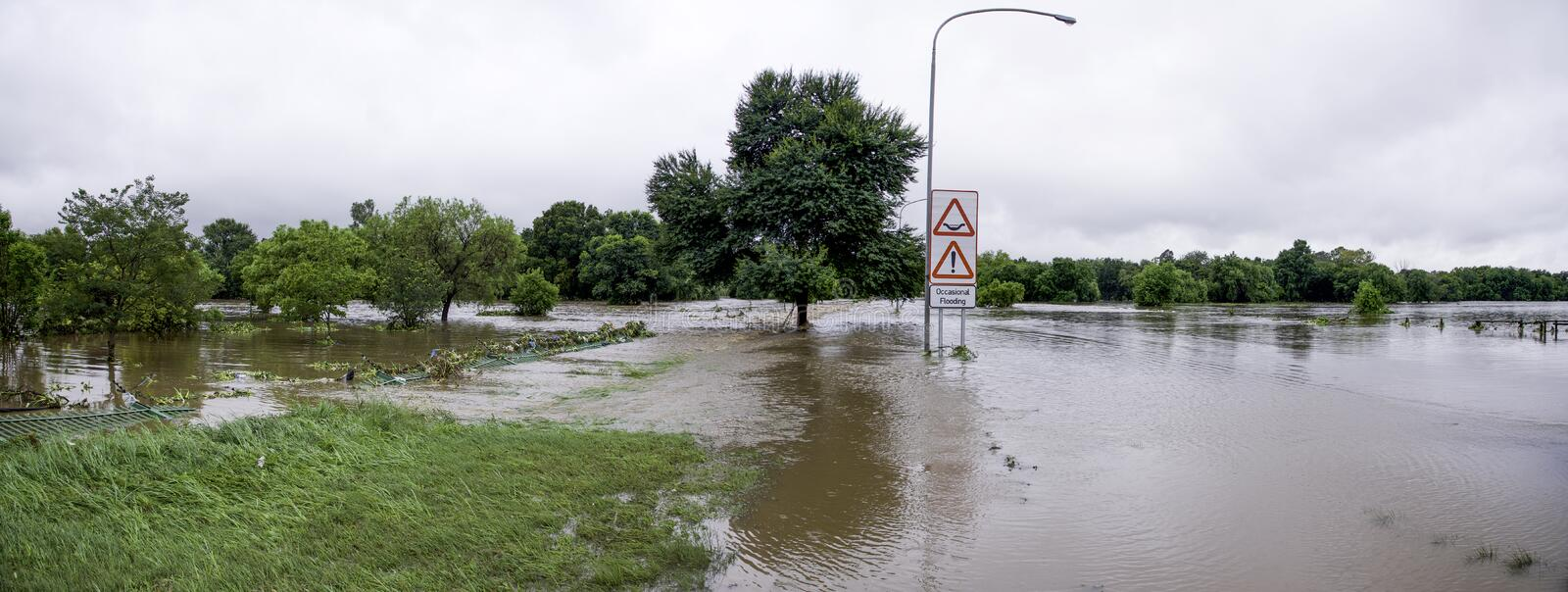 Natural disaster that took place in South Africa. A panoramic image showing the flooding of a public road in Centurion, South Africa.  The Hennops River burst royalty free stock photography