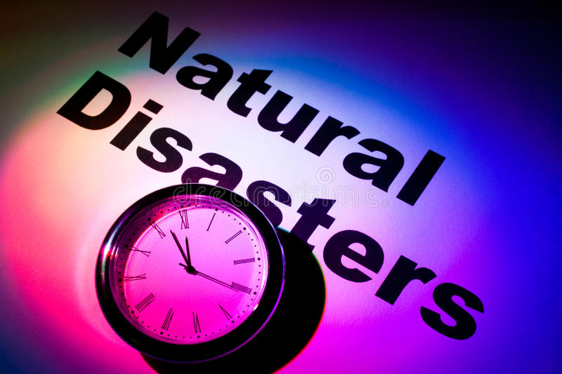 Natural Disasters. Clock and word of Natural Disasters for background stock photo