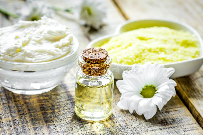 natural essential aroma oil with camomile on wooden table backgr stock photo