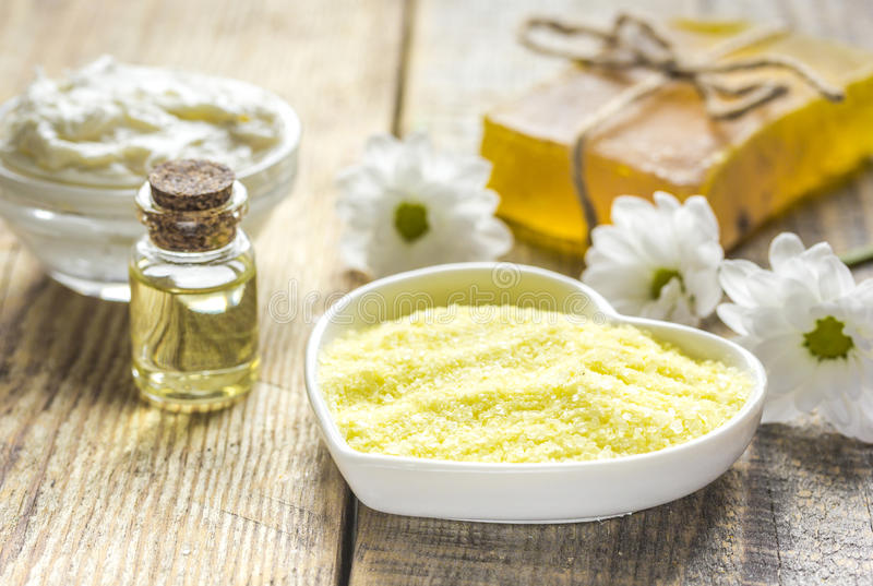 Natural essential aroma oil with camomile on wooden table background royalty free stock photography