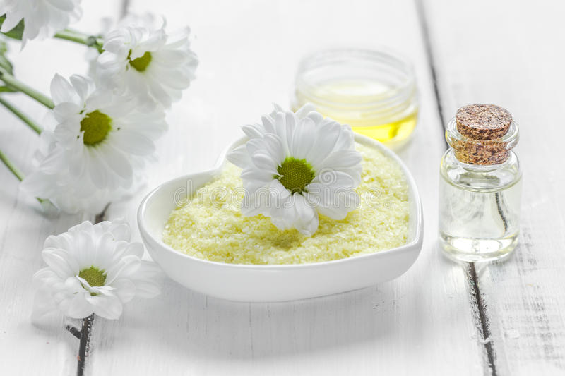 Natural essential aroma oil with camomile on wooden table background stock photos