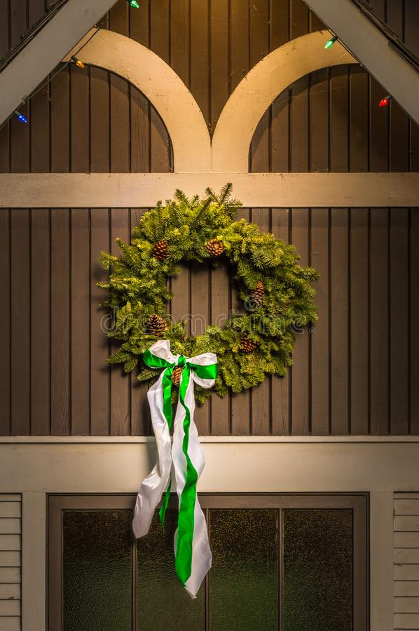 Natural evergreen Christmas wreath on side of old building. stock image