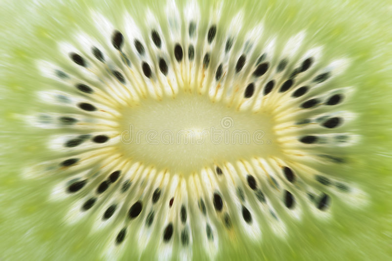 Natural explosive abstract background. Green cut kiwi stock images