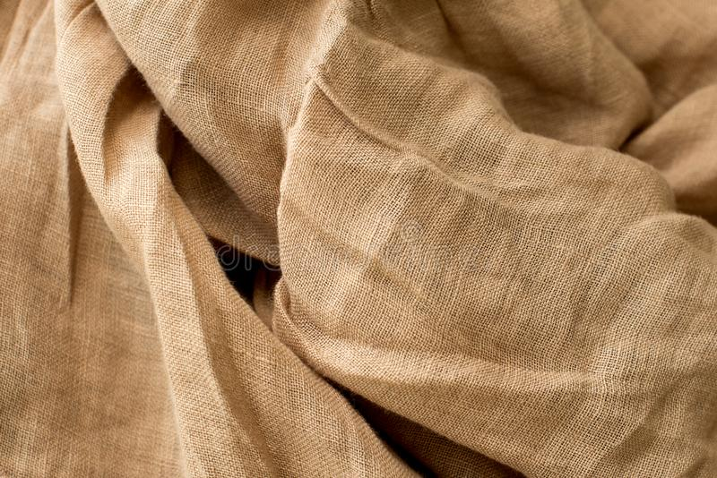 Natural fabric linen texture, beige color, unbleached material for design. stock photography