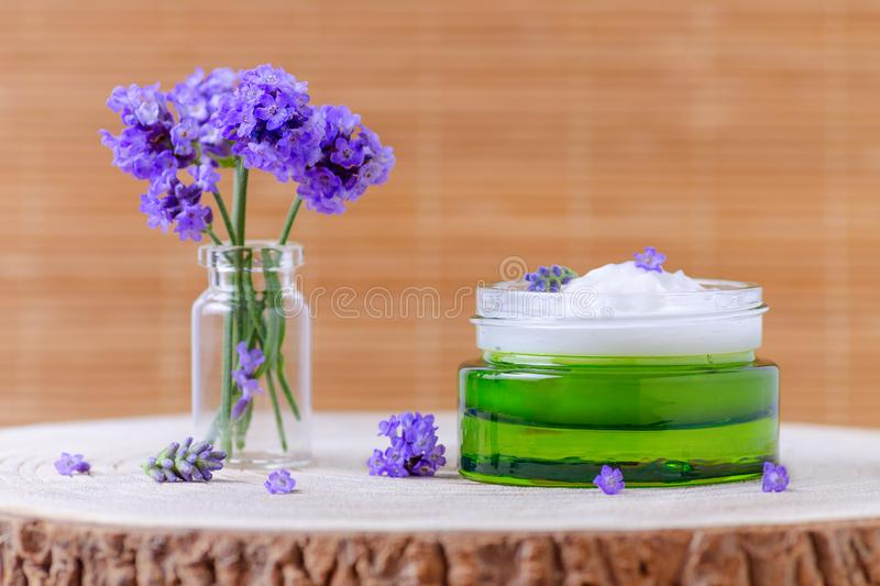Natural face cream with fresh lavender flowers, selective focus. Natural face cream with fresh lavender flowers, organic cosmetics royalty free stock photography