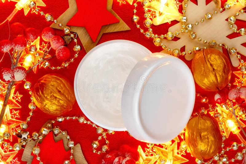 Natural face cream jar on festive Christmas background top view. Womans New Year present idea stock photos