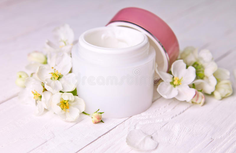 Natural facial cream with apple blossom royalty free stock photos