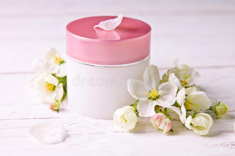 Natural facial cream with apple blossom royalty free stock images