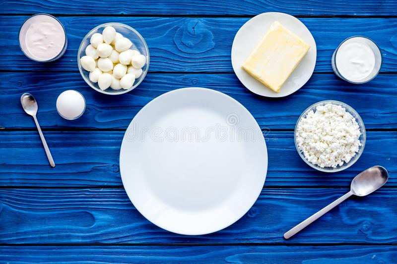 Natural farm products. Milk, cottage, eggs, cheese, yougurt on blue background top view copy space royalty free stock image