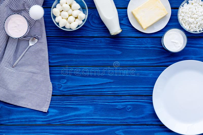 Natural farm products. Milk, cottage, eggs, cheese, yougurt on blue background top view copy space stock images