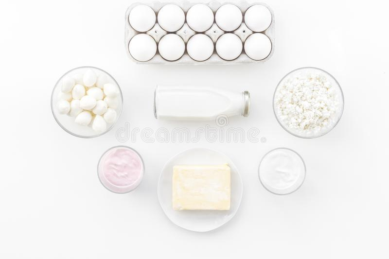 Natural farm products. Milk, cottage, eggs, cheese, yougurt on white background top view. Monochrome royalty free stock photo