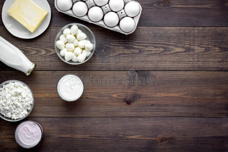 Natural farm products. Milk, cottage, eggs, cheese, yougurt on wooden background top view copy space royalty free stock photos