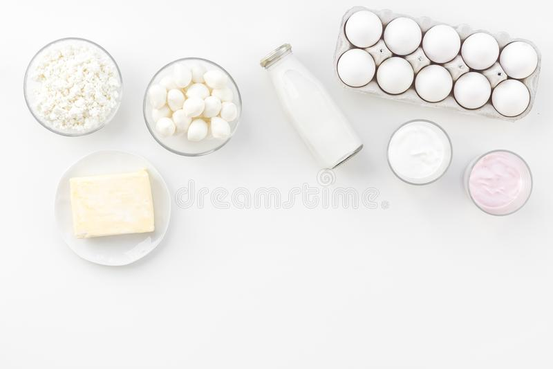 Natural farm products. Milk, cottage, eggs, cheese, yougurt on white background top view copy space. Monochrome stock photography