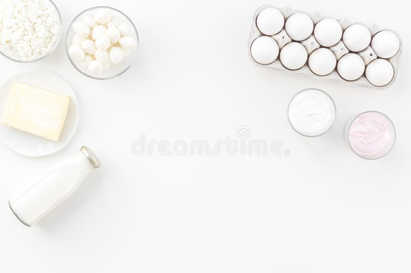 Natural farm products. Milk, cottage, eggs, cheese, yougurt on white background top view copy space. Monochrome royalty free stock photos