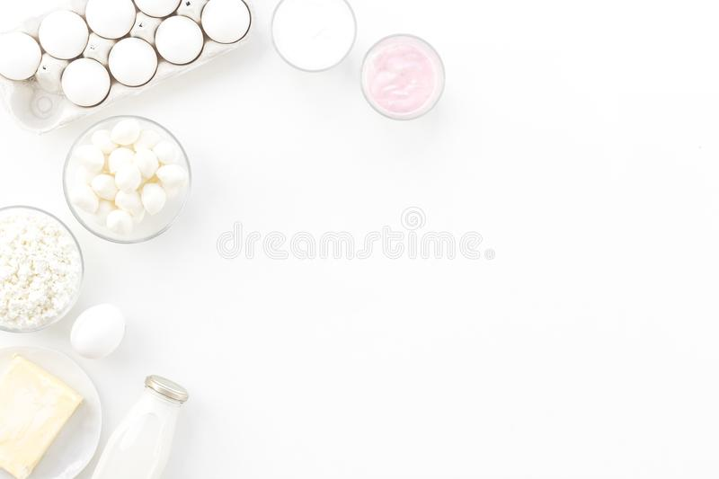 Natural farm products. Milk, cottage, eggs, cheese, yougurt on white background top view copy space. Monochrome stock photo