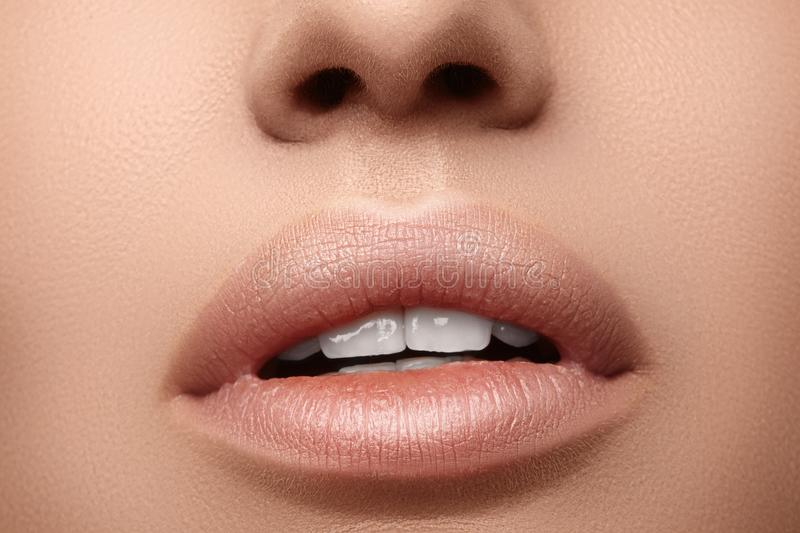 Natural fashion lipstick. Close-up beautiful lips. Full lips with lip makeup. Filler Injections, Plastic Surgery stock images