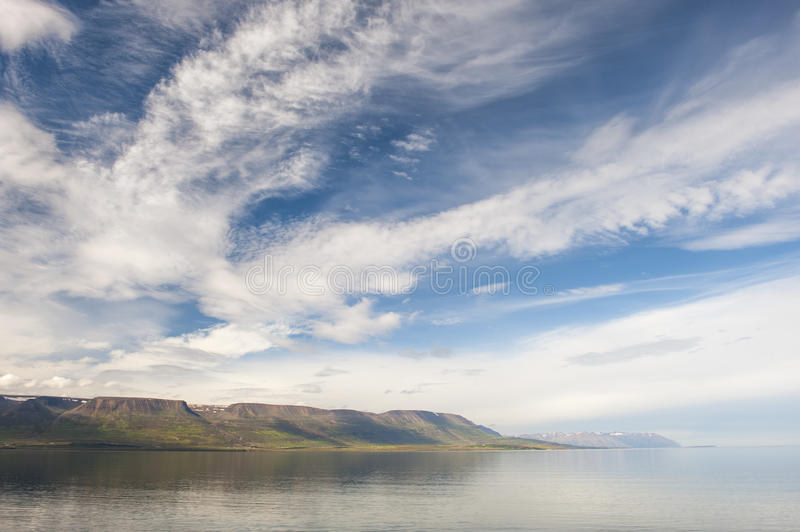 Natural fjord landscape with mountains and clouds, polar filter, Iceland royalty free stock photography