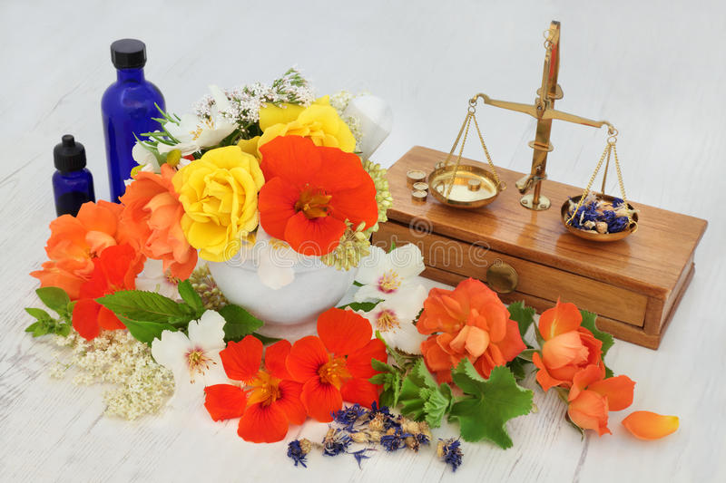 Natural Flower and Herbal Therapy. Natural flower and herb therapy with elderflower, valerian, cornflower, nasturtium, orange blossom, rose, marjoram and ladies stock photography