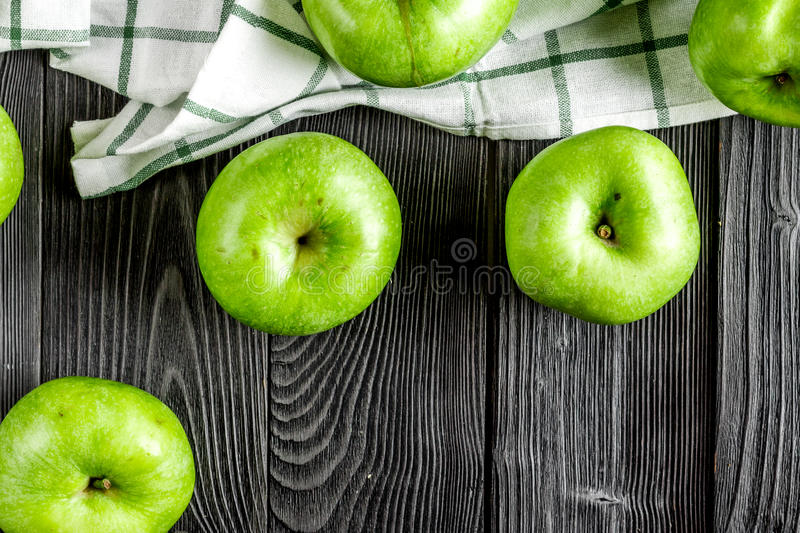 Natural food design with green apples dark desk background top view stock photo