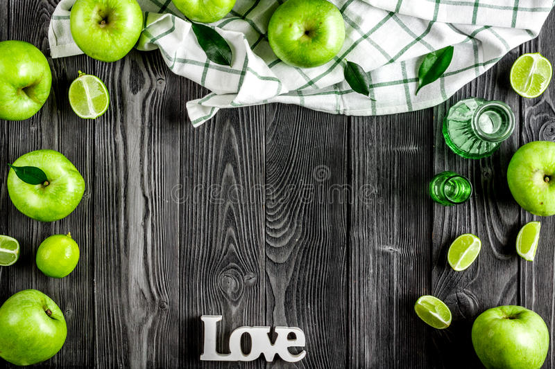 Natural food design with green apples and love text dark desk background top view mock up stock photo