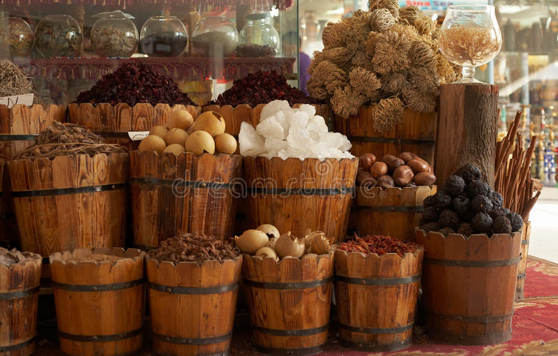 Natural food items and medical herbs in tub contai royalty free stock photography