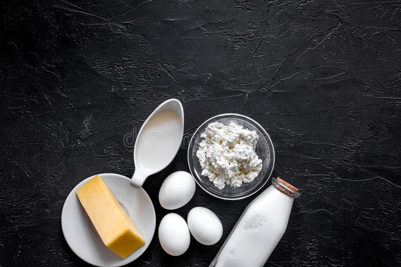 Natural food. Milk, cottage, cheese, eggs on black stone background top view copyspace stock images