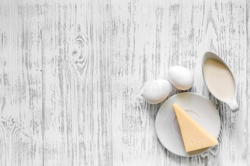 Natural food. Milk, eggs, cheese on light wooden background top view copyspace royalty free stock photos