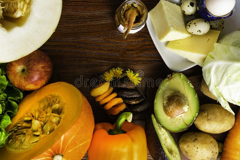 Vitamin A in food, Natural products rich in vitamin A as pepper, pumpkin, apple, potato, cabbage, avocado,dried apricots, melon, c. Natural food products rich in royalty free stock images