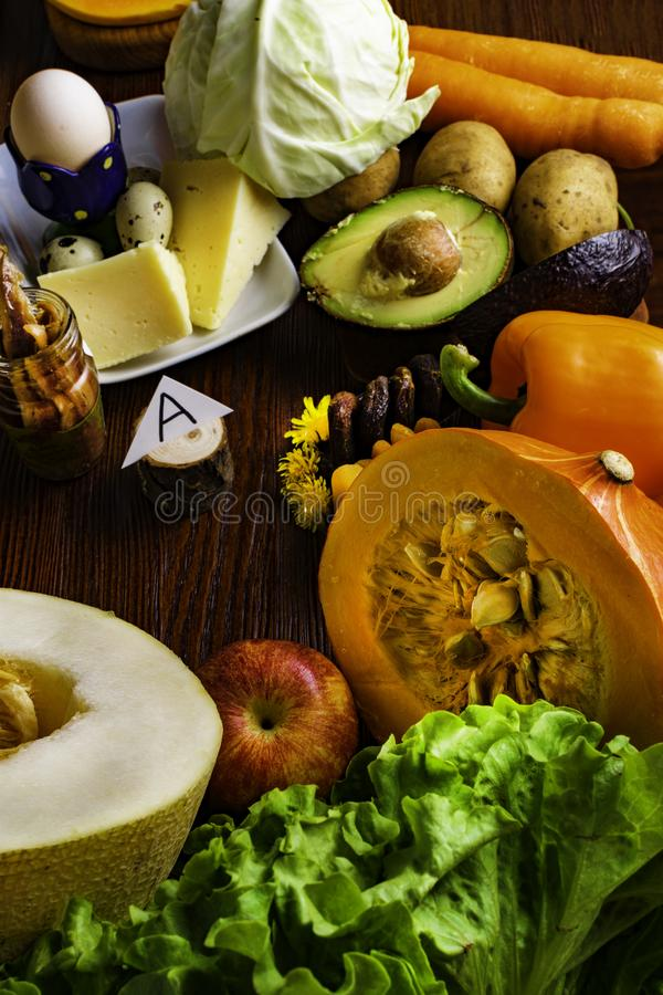 Vitamin A in food, Natural products rich in vitamin A as pepper, pumpkin, apple, potato, cabbage, avocado,dried apricots, melon, c. Natural food products rich in royalty free stock image