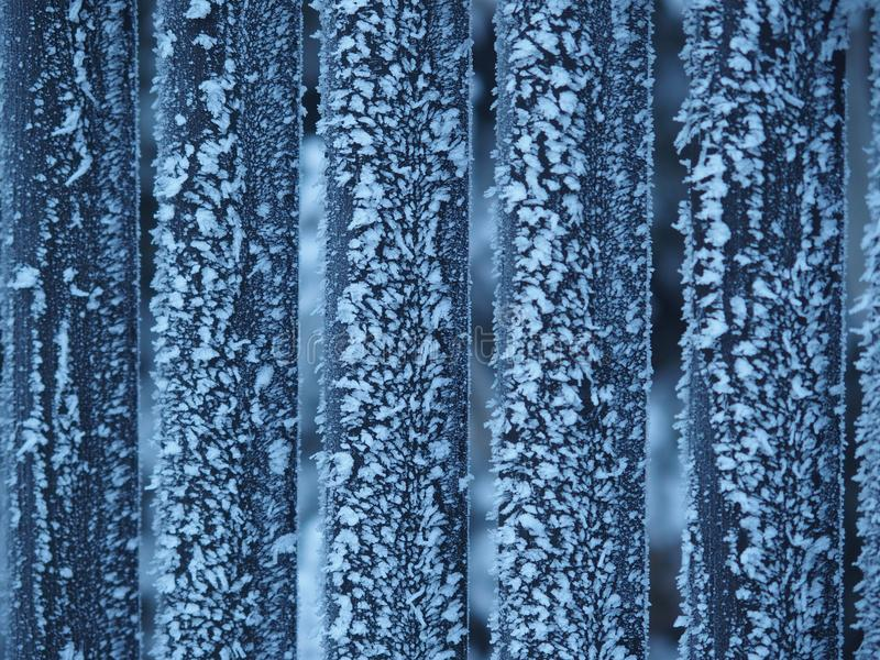 Frosty wood frence in winter. Natural frosty wood fence in winter season, icy cold, only our beautiful nature can creates something like this royalty free stock photo