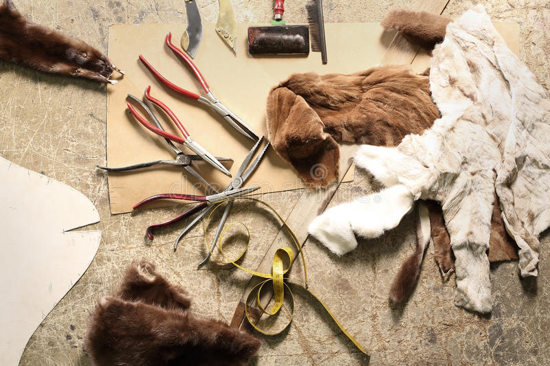 Natural fur tailor made workshop furrier stock photo