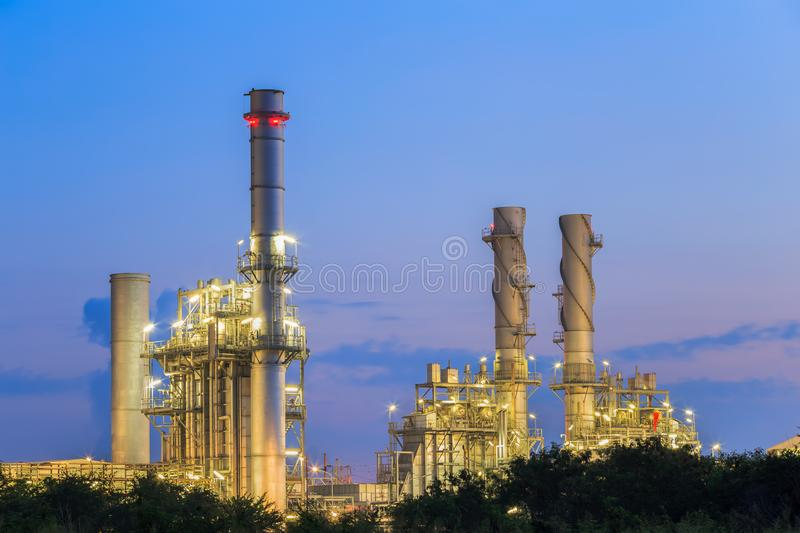 Gas turbine electric power plant in the morning. Natural gas combine electric power plant at dust in the morning stock images