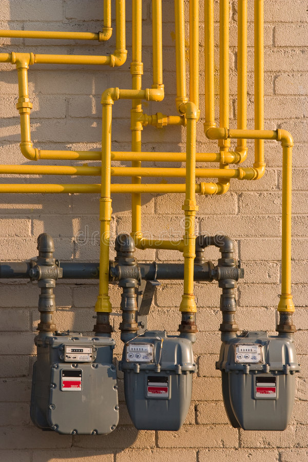 Natural Gas meters & pipes. Maze of pipes and natural gas meters. Concept for raising energy or utility costs, evironmental concerns or advantages of alternative stock photo