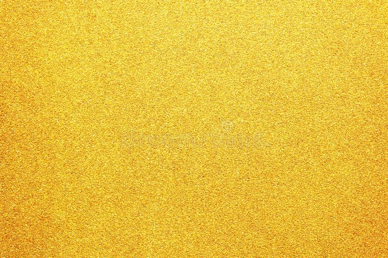 Gold colored glitter paper abstract or vintage texture background. Natural gold colored glitter paper abstract or vintage texture background royalty free stock images