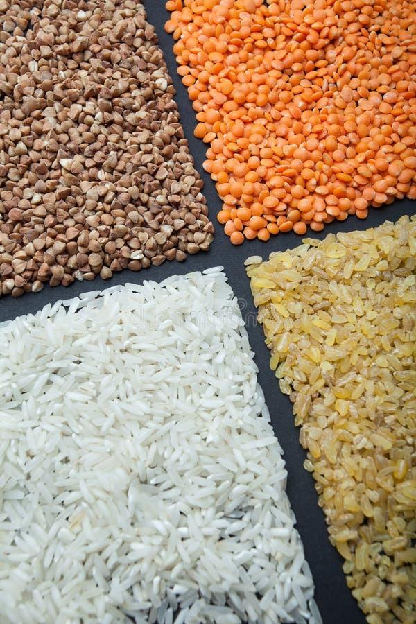 Natural grains: rice, lentils, bulgur and buckwheat. Vertically. Natural grains: rice, lentils and bulgur and buckwheat. Vertically stock photos