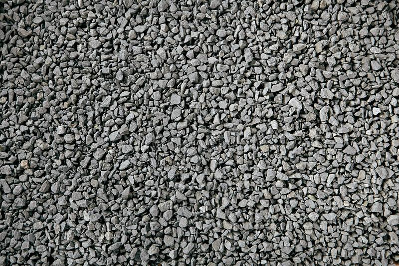 Natural Gray Granite Chippings, Macadam, Rubble or Crushed Stones Background Top View stock images