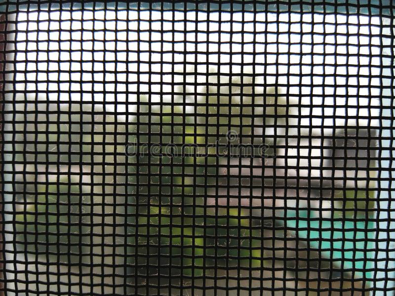 Natural green garden behind black dirty net with cobweb stock images