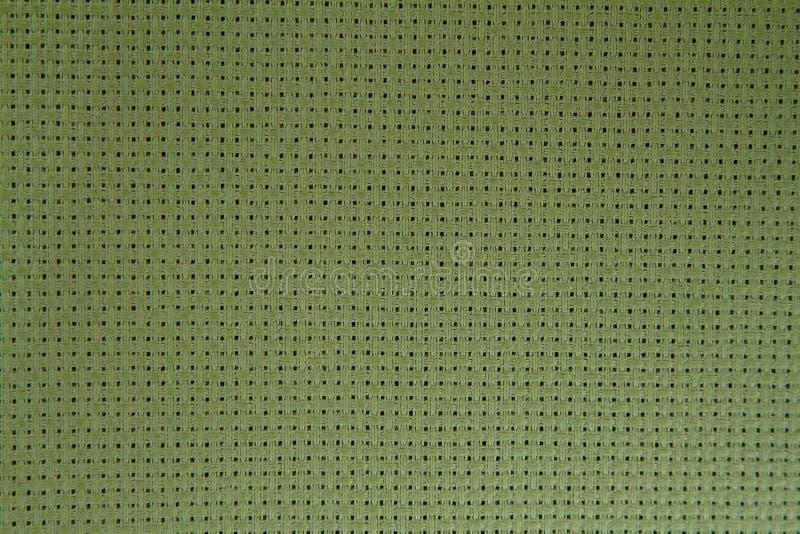Natural green linen fabric texture for background. Macro focus stock photos