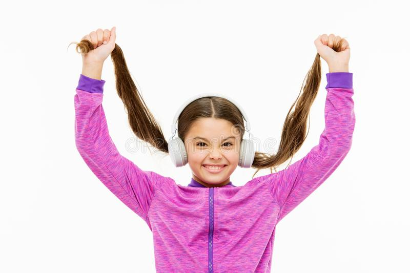 Natural hair extensions. Little child with long ponytail hair isolated on white. Small girl with brunette hair. Cute kid. With fashionable hairstyle wearing stock images