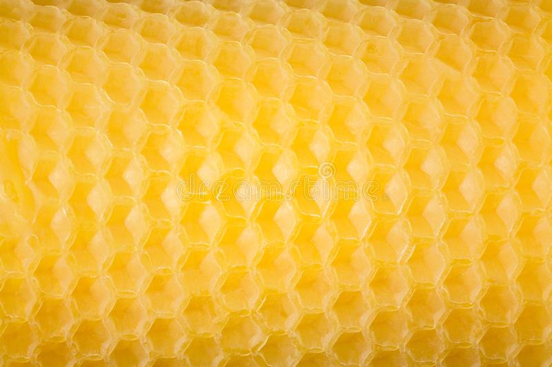 Natural handmade beeswax candle. Close up. Honey comb pattern royalty free stock image