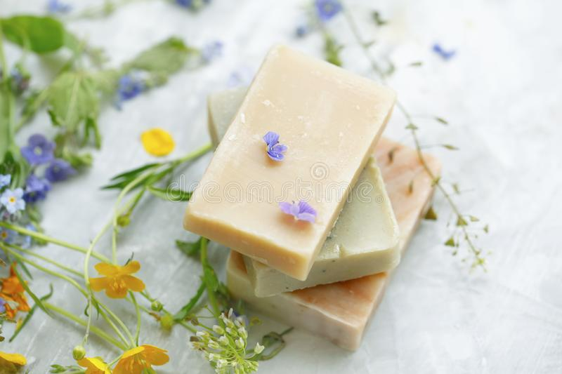 Natural handmade soap bars with organic medicinal plants and flowers.Homemade beauty products with natural essential oils from. Plants and flowers, top view royalty free stock photography