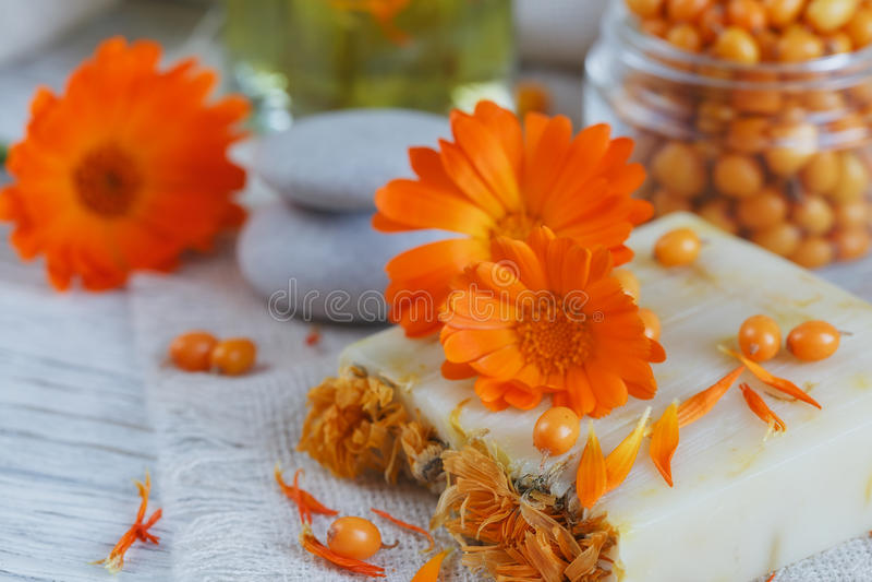 Natural handmade soap with calendula and sea buckthorn stock photo