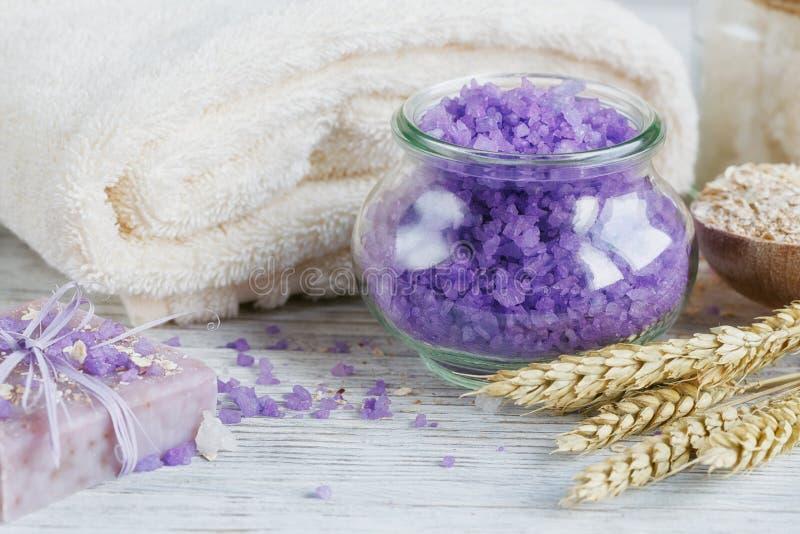 Natural handmade soap, sea salt, towel, oat flakes and wheat ear stock photos