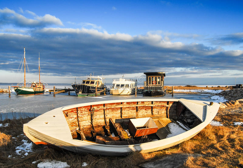 Natural Harbor with boats in the winter. With frozen water stock photography