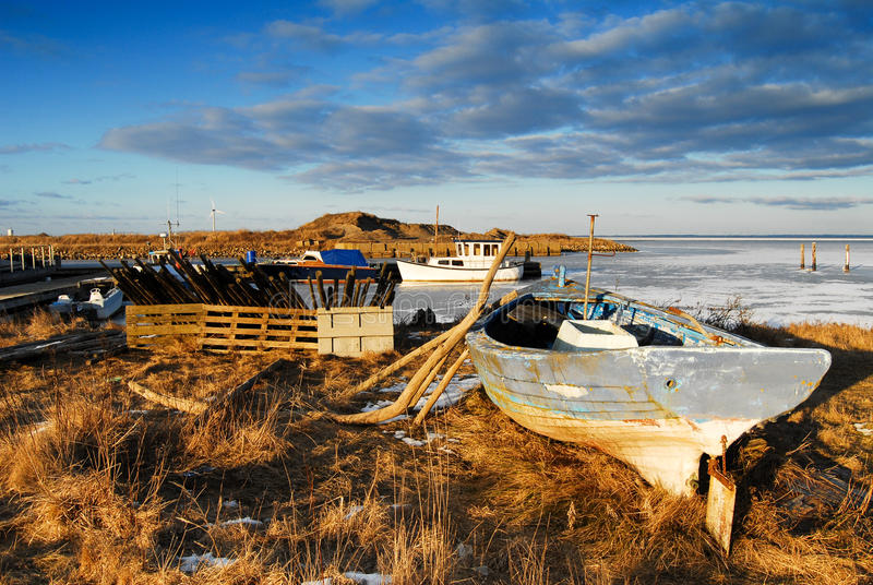 Natural Harbor with boats in the winter. With frozen water royalty free stock photo